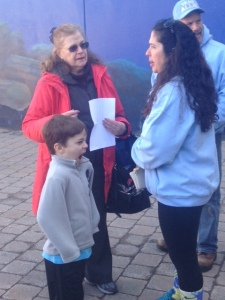 Esther Gómez-Nieto greeting attendees of a WDSD celebration at the Long Island Aquarium.